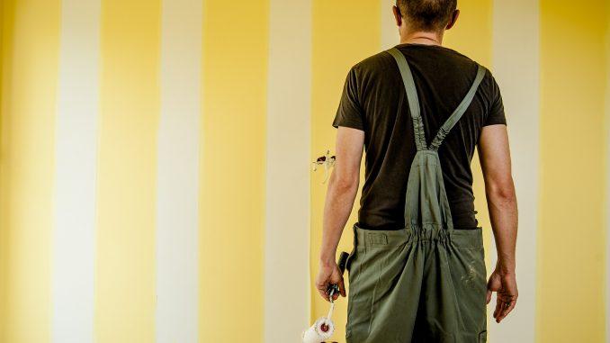 Painter staring at wall