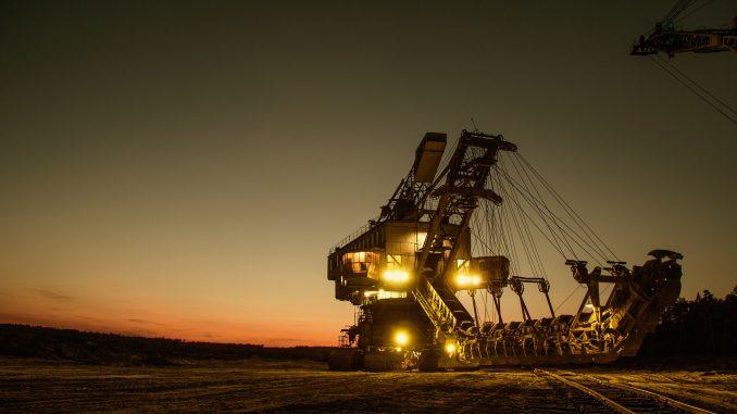 Mining excavator at sunset