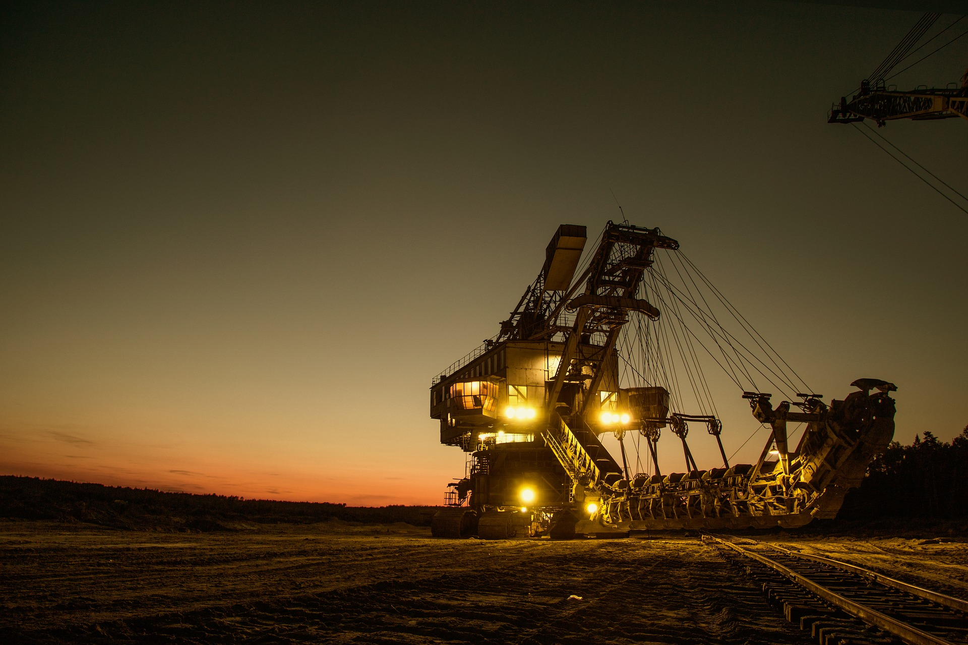 Mining excavator at sunset