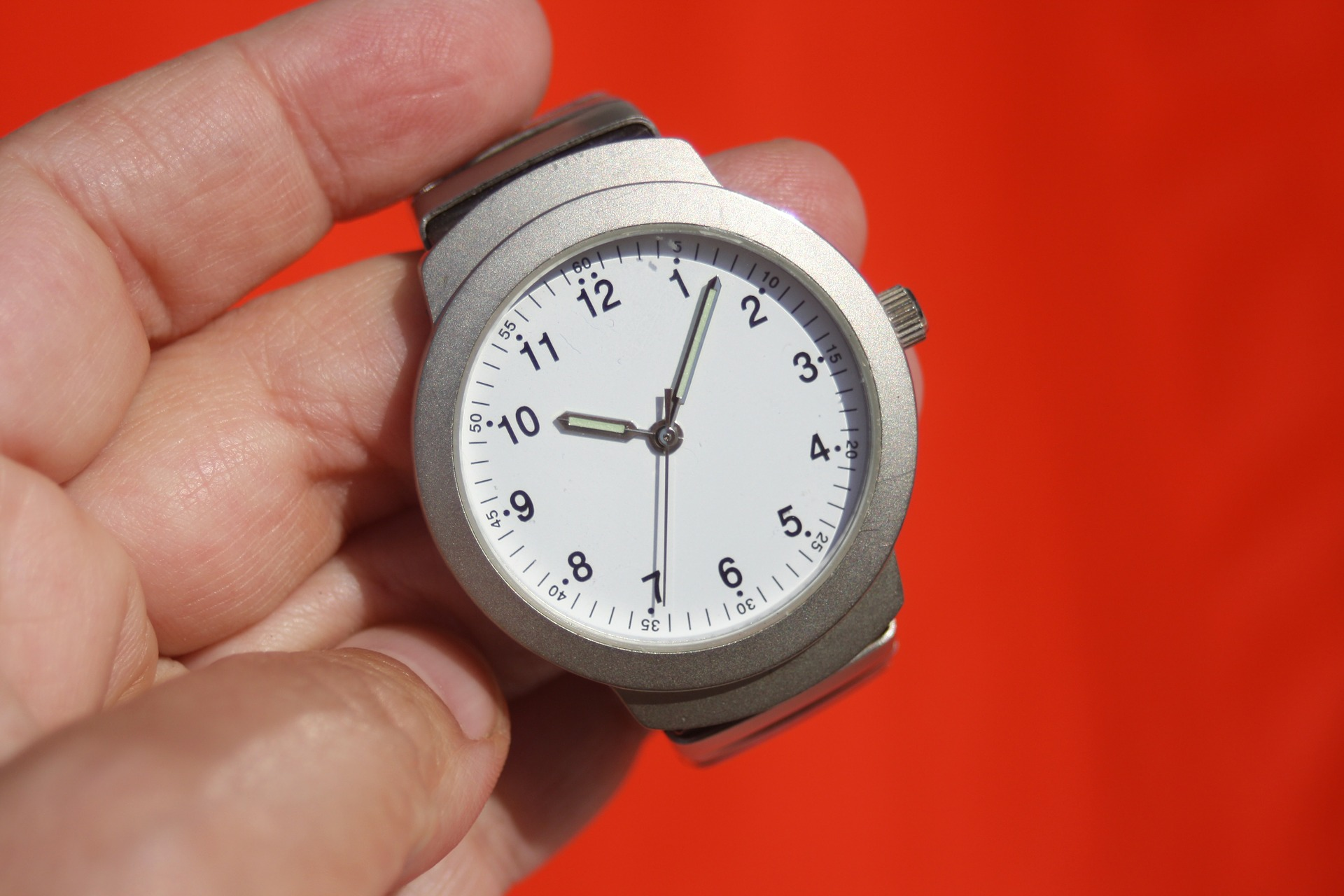 Image of clock in hand