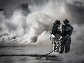 Firefighters fighting fire and smoke